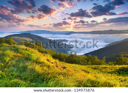 Stock Photo Beautiful summer landscape in the mountains. Sunrise