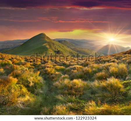 Beautiful summer landscape in the mountains. Sunset with dramatic sky
