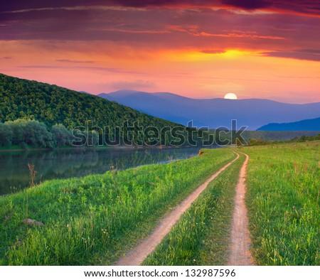 Beautiful summer landscape on the mountain river. Sunrise