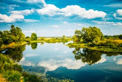 Beautiful summer landscape with river and blue sky in Belarus Russia