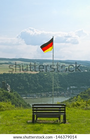 Beautiful summer landscapeand, view on the river Rhein and German flag above the German town of St. Goarshausen in Rhineland-Palatinate