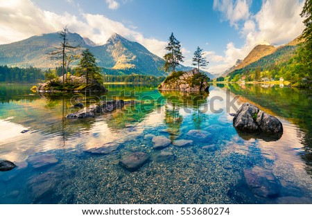 Beautiful summer morning on the Hintersee lake. Colorful outdoor scene in the Austrian Alps, Salzburg-Umgebung district, Austria, Europe. Artistic style post processed photo.
