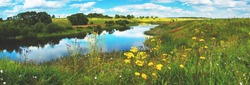 Beautiful summer or spring panoramic rural landscape with calm river and green hills with blooming wild flowers and trees at sunny summer day.River Upa in Tula region,Russia.