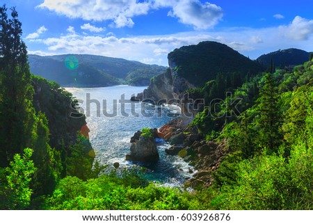 Beautiful summer panoramic seascape. View of the coastline into the sea bays with crystal clear azure water. Lonely rock with a tree on top. A small tree on top. Paleokastrica. Corfu. Greece. - Shutterstock ID 603926876