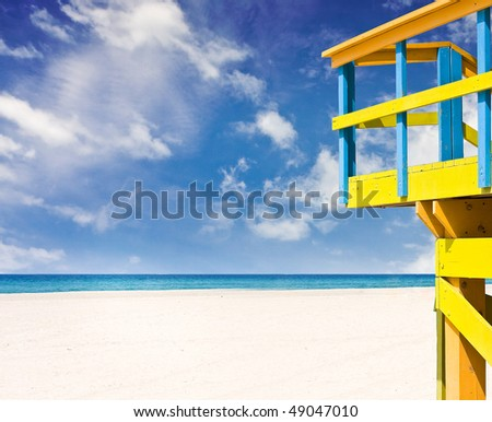 Beautiful summer scene with a typical colorful lifeguard house in Miami Beach Florida with lots of copy space