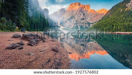 Beautiful summer scenery. Calm morning view of Braies (Pragser Wildsee) lake. Fantastic summer sunrise in Fanes-Sennes-Braies national park, Dolomiti Alps, South Tyrol, Italy, Europe.  Zdjęcia stock ©