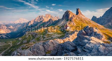 Beautiful summer scenery. Splendid sunrise in Tre Cime Di Lavaredo National park. Panoramic summer view of rifugio Locatelli in Dolomiti Alps, South Tyrol, Italy, Europe. Traveling concept background. Zdjęcia stock ©