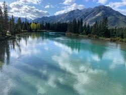 Beautiful summer sky reflected on mountain lake