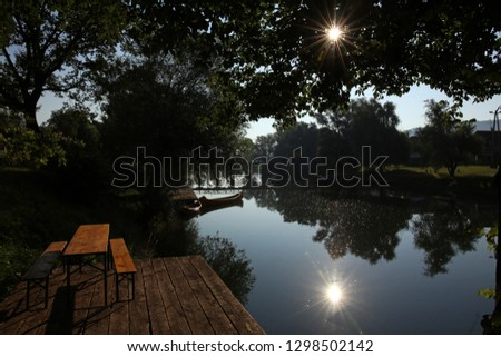 Beautiful summer sunrise by the river Krka, town Kostanjevica in Slovenia. Stock photo ©