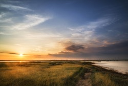 Beautiful Summer sunset landscape over wetlands and harbor