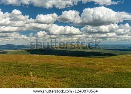 Beautiful summer view over the Swedish mountains or fjeld word in Northern Sweden with blue sky and fluffy white clouds