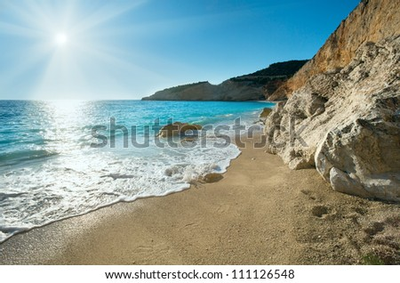 Beautiful summer white Porto Katsiki beach on Ionian Sea (Lefkada, Greece) with sun in sky