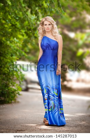 Beautiful summer woman fashion girl in trendy dress at vacation. Alluring sexy blonde walking on street. Summer beauty woman outdoors. lovely woman in romantic dress in park elegant woman sensual girl