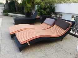 beautiful sun bed on cement floor