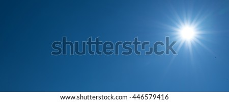 Beautiful sun over blue sky #446579416