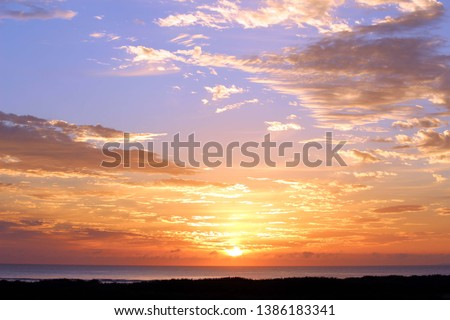 beautiful sun rise off the beach #1386183341