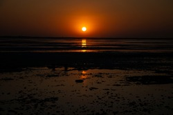 Beautiful Sun Set at Great Rann of Kutch. Golden Sun Setting in White desert with reflection on the wet surface of desert.