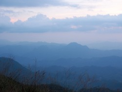Beautiful sun set sky with layers of mountains at Doi Tu Lay (Tu Lay Mountain), Tak province, Thailand