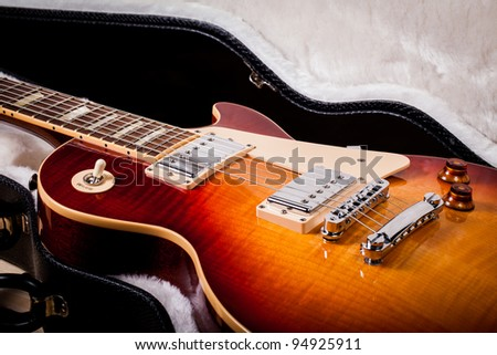 Beautiful Sunburst Electric Guitar Laying in a Hard Shell Electric Guitar Case