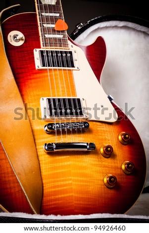 Beautiful Sunburst Electric Guitar Standing Up Inside a Hard Shell Electric Guitar Case