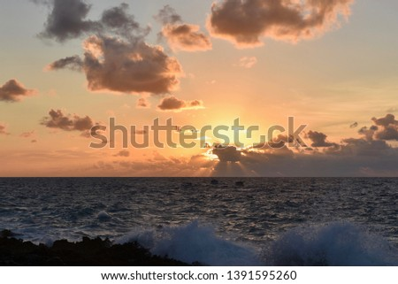Beautiful sundown landscape. Golden horizon. Two small boat silhouette. Breaking wave rough water in the Grand Cayman Island. #1391595260