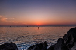 Beautiful sundown on the sea with sky reflections, nature background