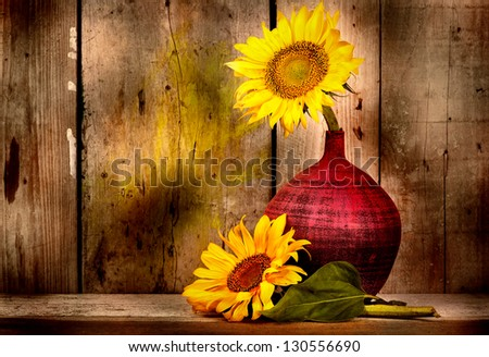 Beautiful sunflowers with and old weathered wood planks background