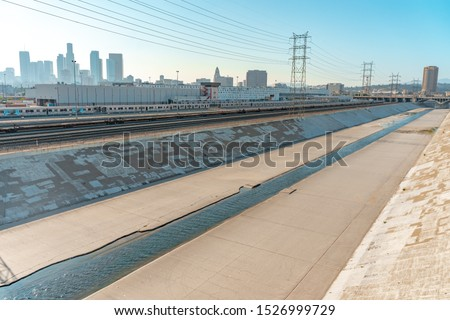 Beautiful sunny day at LA river. Concrete river. Cinematic place. Los Angeles downtown.  ストックフォト ©