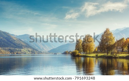 Shutterstock Beautiful Sunny day in Alps. wonderlust view of highland lake With autumn trees under sunlight and perfect sky. Landscape with Alps and Zeller See in Zell am See, Salzburger Land, Austria