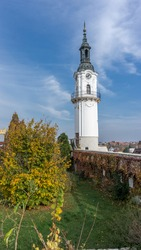 Beautiful sunny day scenery of a city landmark, Veszprém Fire-watch Tower, tall white tower with its stunning architecture attracting many visitors and tourist coming to his Hungarian town.