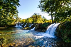 Beautiful sunny day. Scenic waterfall cascades on the river Sluncica. Magnificent Southern Europe, Croatia, small town Slunj. The concept of ecological, active and photo tourism