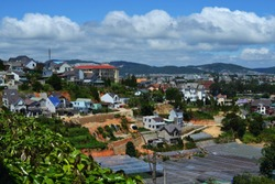 Beautiful sunny summer view of the town of Dalat in Vietnam. Old French houses in the heart of an Asian country. Incredible blue sky in the clouds over the city.