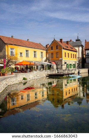 Beautiful sunny view of lake Malom with colors houses in Tapolca. Reflection photo of a romantic part of the town is the Mill Pond (Malom-tó).  Stock fotó ©