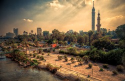 Beautiful sunrays and Cairo cityscape at sunset