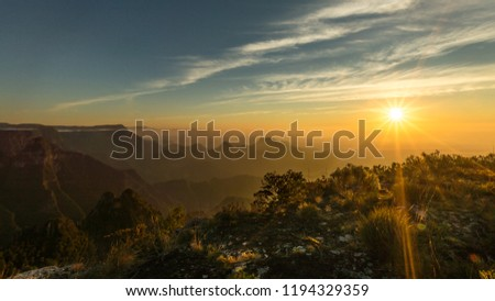 Beautiful sunrise and colorful sky over the hills and canyons during a trekking in Canion do Funil, Urubici, Santa Catarina - Brazil #1194329359