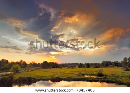 Beautiful sunrise and dramatic clouds on the sky. Flood waters of Narew river, Poland. #78457405
