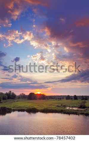 Beautiful sunrise and romantic clouds on the sky. Flood waters of Narew river, Poland.