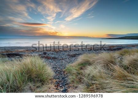Beautiful sunrise at New England Bay at Kirkmaiden near Ardwell on the Galloway coast of Scotland #1289596978
