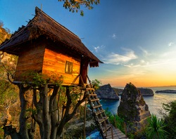 Beautiful sunrise at the famous tourist location the Nusa Penida tree house overlooking the Thousand Islands viewpoint near Bali, Indonesia