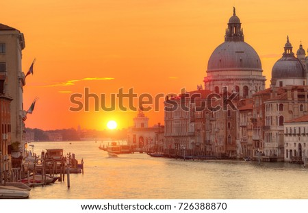 Beautiful sunrise in Grand canal with Church of Santa Maria della Salute in detail, Venice, Italy, European Union. Famous historical heritage.