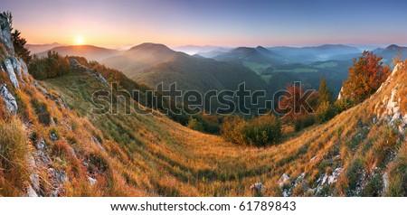 Beautiful sunrise in mountain valley with sun