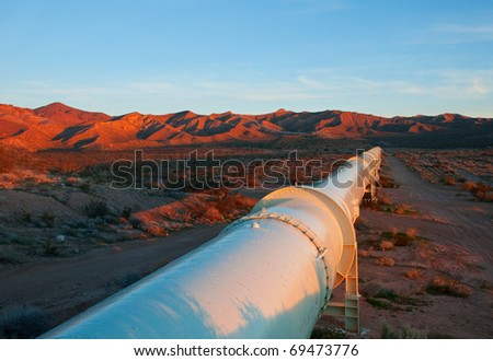 Beautiful sunrise lighting on a pipeline in the Mojave Desert.