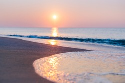 Beautiful Sunrise on Beach Ocean Scene with Blue Wave on Seashore with Reflection of Sun Rays on the Water. Tranquil, Relaxing Travel Vacation Image