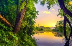 Beautiful sunrise on calm lake in forest nature landscape