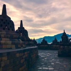 Beautiful sunrise on path through Borobudur Temple - Yogyakarta, Indonesia