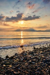 Beautiful sunrise on the shore of the tiny Isola Superiore Island on Lake Maggiore - one of the famous Lakes in northern Italy, Europe.