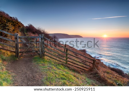 Beautiful sunrise on the South West Coast Path at Pencarrow Head looking out to Lantivet Bay on the south coast of Cornwall
