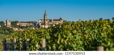 Beautiful sunrise on the steeple of the church and village of Saint-Emilion, Religion, Gironde, France,