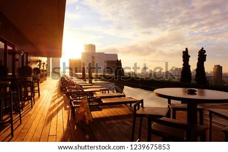Beautiful sunrise over a hotel rooftop swimming pool on Penang Island, Malaysia #1239675853