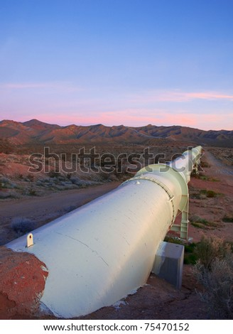 Beautiful sunrise over a pipeline in the Mojave Desert, California.